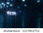 rain drops on window with... | Shutterstock . vector #1217812711