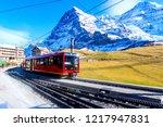 swiss train at kleine scheidegg ... | Shutterstock . vector #1217947831