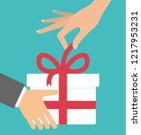 giving a gift concept. man's... | Shutterstock .eps vector #1217953231