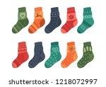 warm knitted socks on white...   Shutterstock .eps vector #1218072997