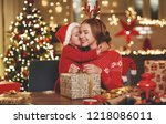 a happy family mother and child ... | Shutterstock . vector #1218086011
