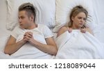 Stock photo shocked couple thinking over first intimate experience lack of sex education 1218089044
