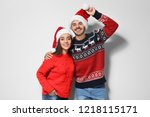 young couple in warm sweaters... | Shutterstock . vector #1218115171