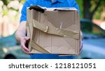 male courier showing damaged... | Shutterstock . vector #1218121051