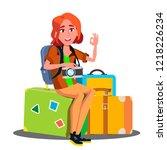 happy girl sitting on pile of... | Shutterstock . vector #1218226234