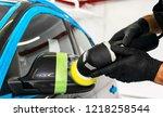 car polish wax worker hands... | Shutterstock . vector #1218258544