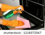 woman cleaning electric oven... | Shutterstock . vector #1218372067