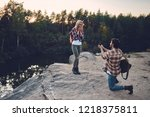 young couple of tourists are... | Shutterstock . vector #1218375811