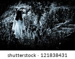 Horror scene of a scary woman. Apparitions of the lady's ghost. - stock photo