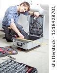 portrait of male plumber fixing ... | Shutterstock . vector #1218428701