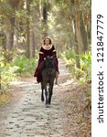 Woman In Medieval Dress Riding...