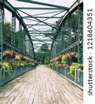 Small photo of Old Drake Hill Flower Bridge is a bridge in Simsbury, Connecticut,United States. Originally carrying Drake Hill Road over the Farmington River. It is one of three surviving Parker truss bridges.