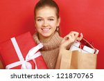 a smiling woman with christmas... | Shutterstock . vector #121870765
