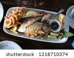 fried fish and seafood plate | Shutterstock . vector #1218710374