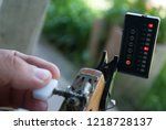 tuning guitar  using a tuned...   Shutterstock . vector #1218728137