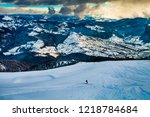 skier in beautiful resort | Shutterstock . vector #1218784684