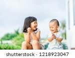 little sister playing with her... | Shutterstock . vector #1218923047