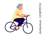 elderly woman on a bicycle.... | Shutterstock . vector #1218955741