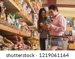 smiling young couple purchasing ... | Shutterstock . vector #1219061164