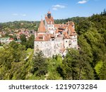bran castle on a hill with high ... | Shutterstock . vector #1219073284