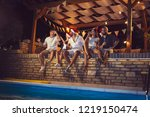 group of young friends sitting... | Shutterstock . vector #1219150474