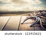 Stock photo lucky horseshoe on a porch 121915621