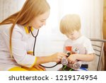 pediatrician examining baby boy....   Shutterstock . vector #1219174954