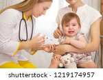 a doctor giving a crying child...   Shutterstock . vector #1219174957