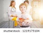 little boy with teddy bear is...   Shutterstock . vector #1219175104
