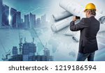 architect holding a smartphone... | Shutterstock . vector #1219186594