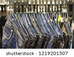 jeans hanging on the rail in... | Shutterstock . vector #1219201507