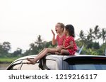 two happy young kid sitting on... | Shutterstock . vector #1219216117