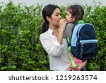 mom feeding her daughter with... | Shutterstock . vector #1219263574