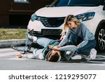 young woman trying to help... | Shutterstock . vector #1219295077