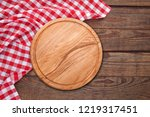 table cloth and pizza board on... | Shutterstock . vector #1219317451