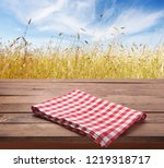 kitchen towel on wooden table.... | Shutterstock . vector #1219318717