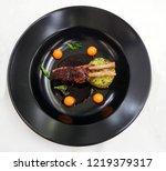 lamb loin chop on medallion of... | Shutterstock . vector #1219379317