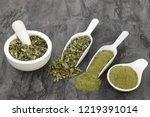 Small photo of Moringa oliefera herb leaf and powder in a mortar with pestle & scoops. Used to treat, anaemia, rheumatism, cancer, diarrhoea, diabetes, constipation, weight loss & has many other health benefits.