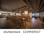 wooden table with stools in... | Shutterstock . vector #1219435417