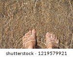 barefoot wade in the aegean sea ...   Shutterstock . vector #1219579921