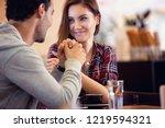 amorous couple sitting on... | Shutterstock . vector #1219594321