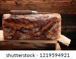 whole grain bread on wooden... | Shutterstock . vector #1219594921