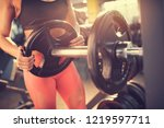 preparing barbell for exercise...   Shutterstock . vector #1219597711