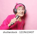 funny old lady listening music... | Shutterstock . vector #1219613437