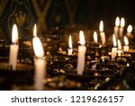 candles are lit for prayer...   Shutterstock . vector #1219626157
