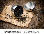 Metal Tea Infuser On Old Woode...