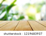 empty wooden table and blurred... | Shutterstock . vector #1219683937