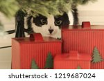 Stock photo cat life cute playful black and white cat hidden behind the christmas tree 1219687024