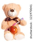 Teddy bear with apple and toothbrush - stock photo