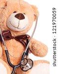 Teddy bear with stethoscope / Pediatrician - stock photo
